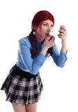Pretty young schoolgirl putting on makeup Stock Images