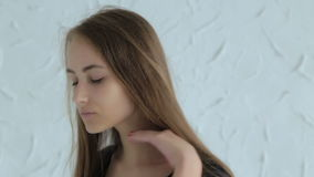 Pretty, young and sensual teen girl with long hair stock video footage