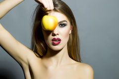 Pretty young sexy girl with apple Stock Images