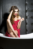 Pretty young sexy girl sitting on bath Royalty Free Stock Photo