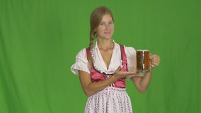 A pretty young sexy Oktoberfest waitress with beers stock footage