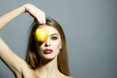 Pretty young sexy woman with apple Stock Photo