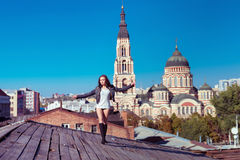 Pretty young sexy woman walks on the wooden roof Stock Photo