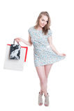 Pretty young shopper woman in summer dress Stock Images