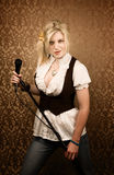 Pretty young singer or comedian with microphone Stock Photos
