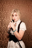 Pretty young singer or comedian with microphone Stock Images