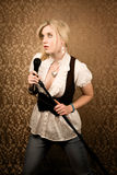 Pretty Young Singer Or Comedian With Microphone Stock Photography