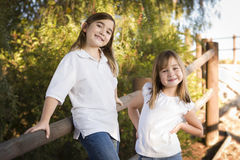 Pretty Young Sisters Portrait Outside Royalty Free Stock Image