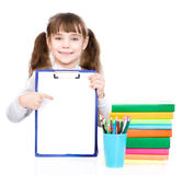 Pretty young smart student pointing towards blank. isolated on white Stock Image