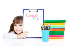 Pretty young smart student pointing towards blank.  on white Stock Photography