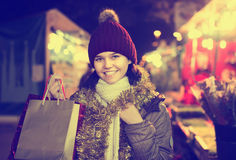 Pretty young smiling girl at Christmas fair Stock Images