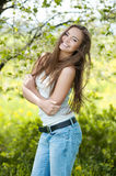 Pretty young smiling girl portrait in a green park Stock Photo