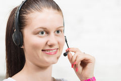 Pretty young smiling woman with headset Royalty Free Stock Photo