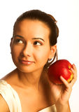 Pretty young smiling woman with red apple. Stock Photos