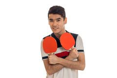 Pretty young sports man playing ping-pong smiling on camera isolated on white background Stock Photos