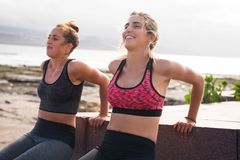Pretty young sporty women exercising together Stock Image