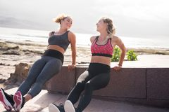 Pretty young sporty women smiling at each other Royalty Free Stock Photos