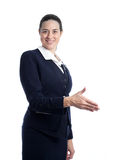 Pretty young stewardess shaking hand Stock Photos