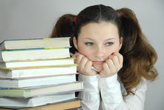 Pretty young student. Student's lessons, tries to read, learn, education receives Royalty Free Stock Photo