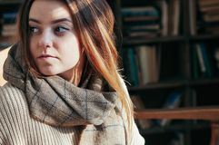 Pretty young student girl in library royalty free stock photography
