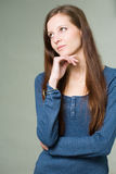 Pretty young student girl pondering. Royalty Free Stock Images