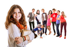 Pretty young student girl portrait with friends Royalty Free Stock Photos