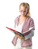Pretty young student girl reading exercise books Stock Image