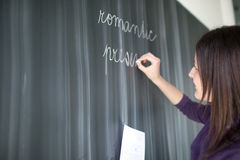 Pretty young  student writing on the blackboard Stock Photos