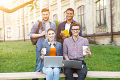 Pretty young students are resting in campus Royalty Free Stock Photo