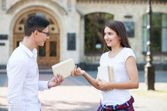 Pretty young students are talking near university Royalty Free Stock Photos