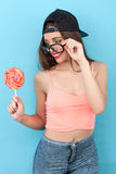 Pretty young styled girl is enjoying sweet Royalty Free Stock Image