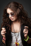 Pretty young stylish girl in black leather jacket and sunglasses royalty free stock photography
