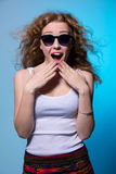 Pretty young surprised girl in sunglasses Stock Photos