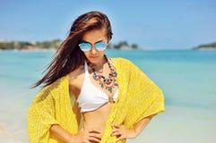 Pretty young tanned woman in bikini posing on the beach Stock Photo