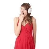 Pretty young teen girl wearing white earmuff Royalty Free Stock Photos