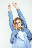 Pretty young teenage girl blond curly hipster fashion glasses emotional posing happy smiling on white background Stock Photos