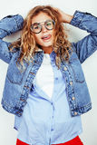Pretty young teenage girl blond curly hipster fashion glasses emotional posing happy smiling on white background Stock Images