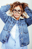 Pretty young teenage girl blond curly hipster fashion glasses emotional posing happy smiling on white background Stock Photo