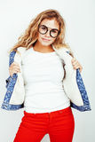 Pretty young teenage girl blond curly hipster fashion glasses emotional posing happy smiling on white background Stock Photography