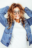 Pretty young teenage girl blond curly hipster fashion glasses emotional posing happy smiling on white background Royalty Free Stock Photo