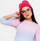 Pretty young teenage girl hipster in pink glasses and hat emotional posing happy smiling, lifestyle people concept. Close up royalty free stock photography