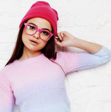 Pretty young teenage girl hipster in pink glasses and hat emotional posing happy smiling, lifestyle people concept Royalty Free Stock Images