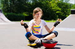 Pretty young teenager sitting meditating Royalty Free Stock Image