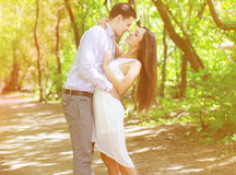 Pretty young teenagers couple in love kiss. Outdoors Stock Photography