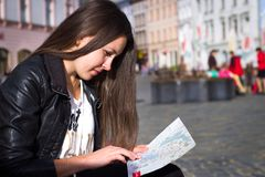Pretty young tourist looking to map historically significant mon. Uments in the city Stock Photos