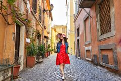Pretty young tourist woman in hat walking. At Trastevere in Rome, Italy Royalty Free Stock Photography
