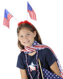 Pretty Young US Patriot. Portrait of a pretty elementary girl dressed to celebrate American's Fourth of July.  On a white background Stock Photo