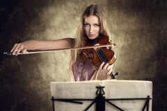 Pretty young violinist playing the violin Royalty Free Stock Image