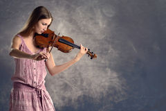 Pretty young violinist playing the violin Stock Photo