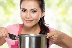 Pretty young wife cooking Stock Images